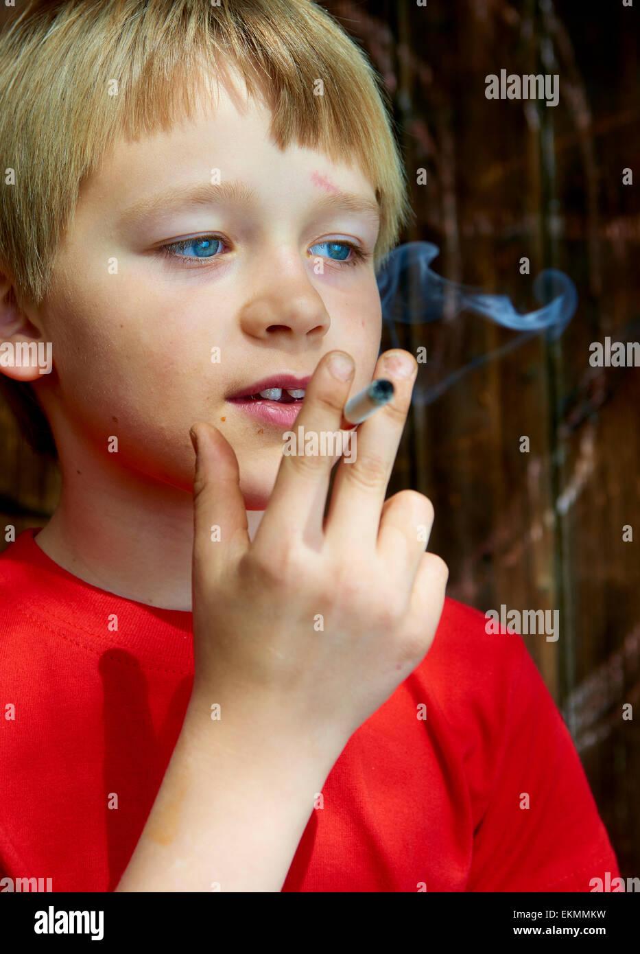 Portrait Of Child Blond Boy Smoking Cigarette With Dark