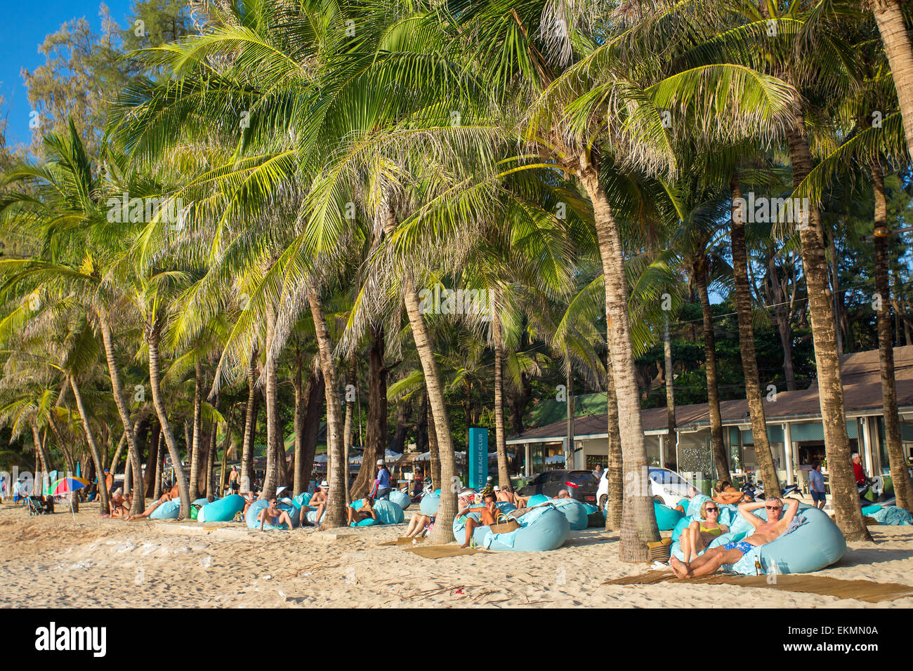 Phuket, Thailand - January 24, 2015: People resting on the couches at the luxury Surin beach on Phuket, Thailand - Stock Image
