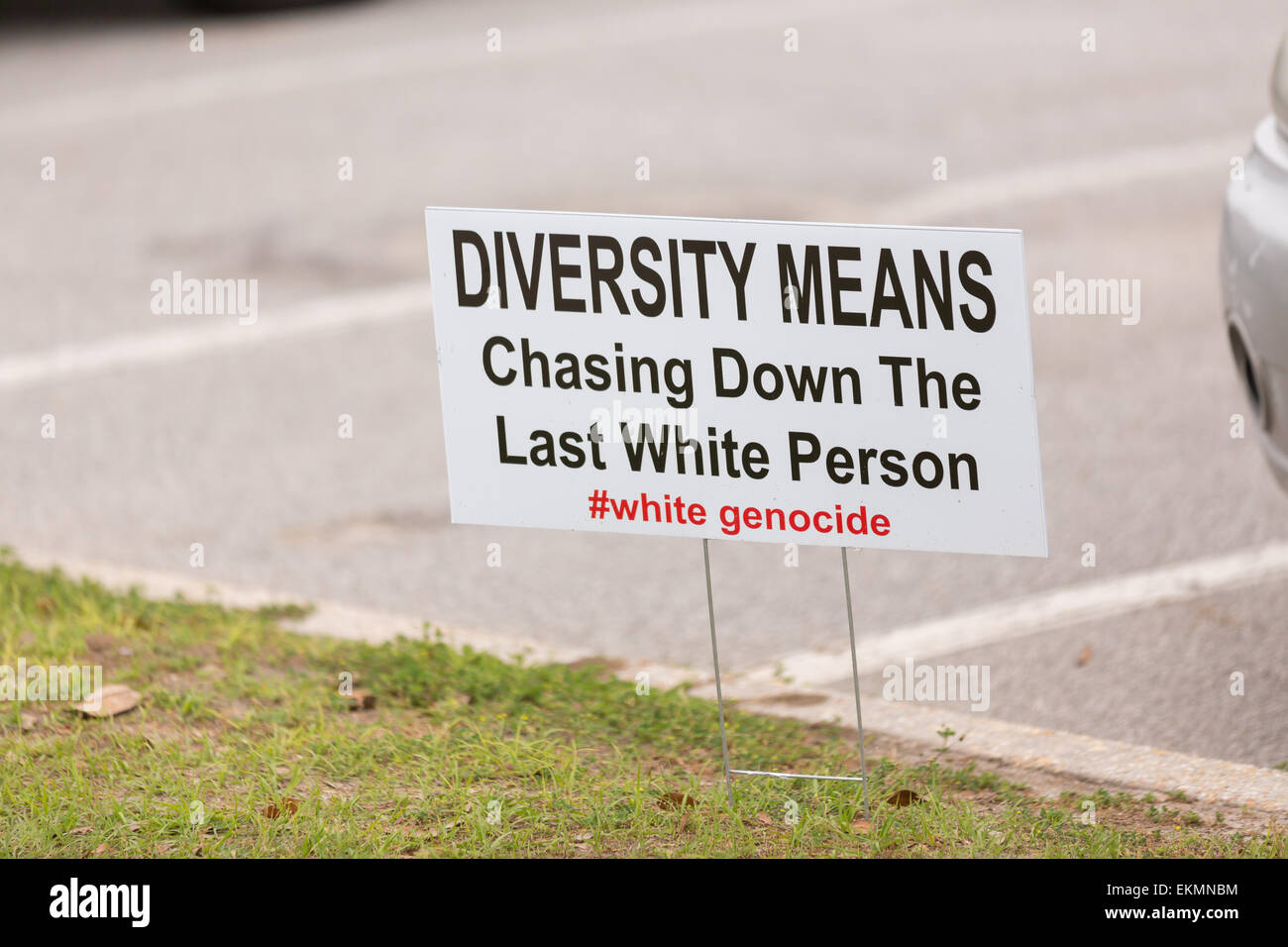 A racist sign along a road in North Charleston following a healing service at Charity Missionary Baptist Church - Stock Image