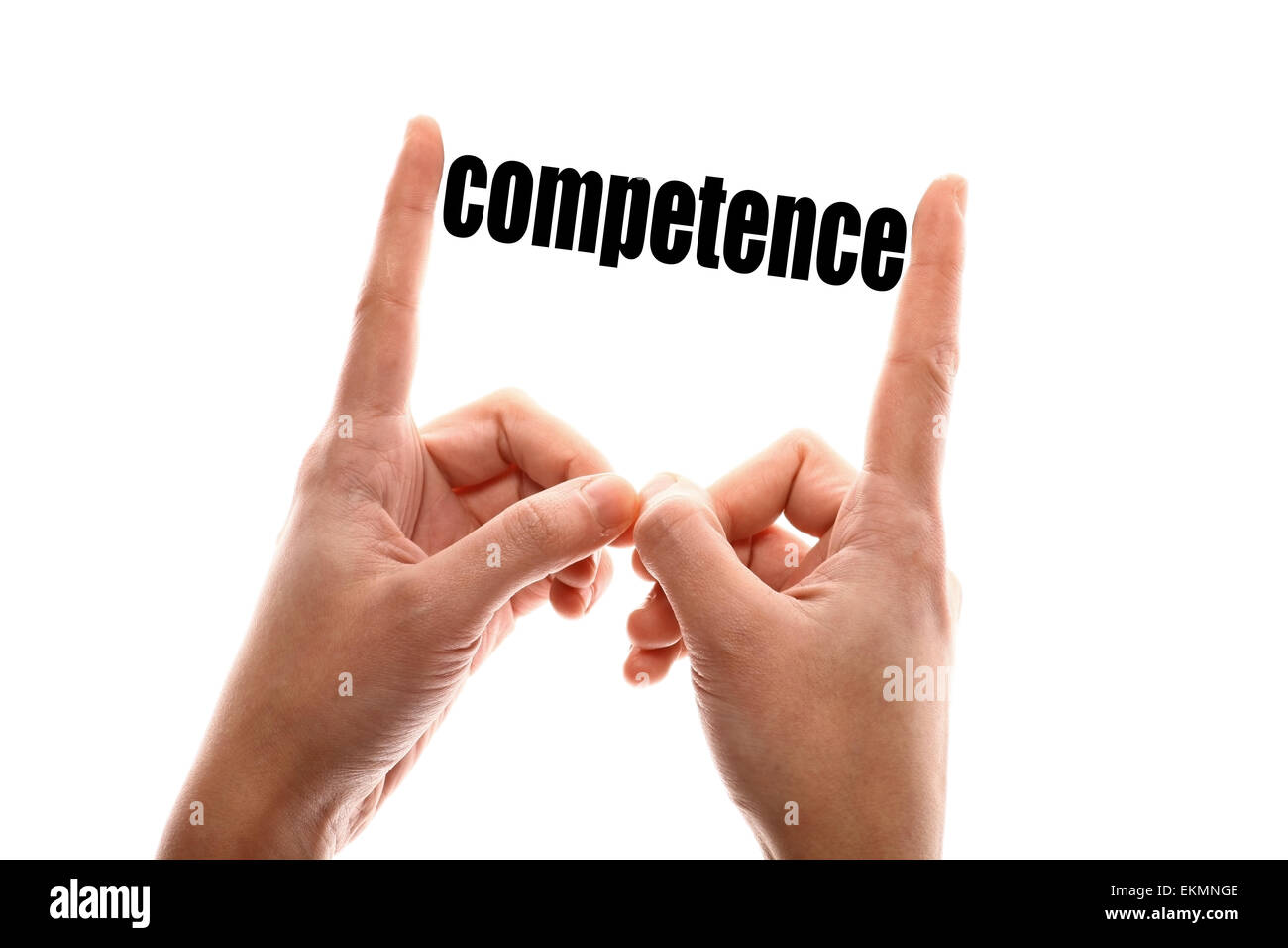 Color horizontal shot of two hands squeezing the word 'competence'. - Stock Image