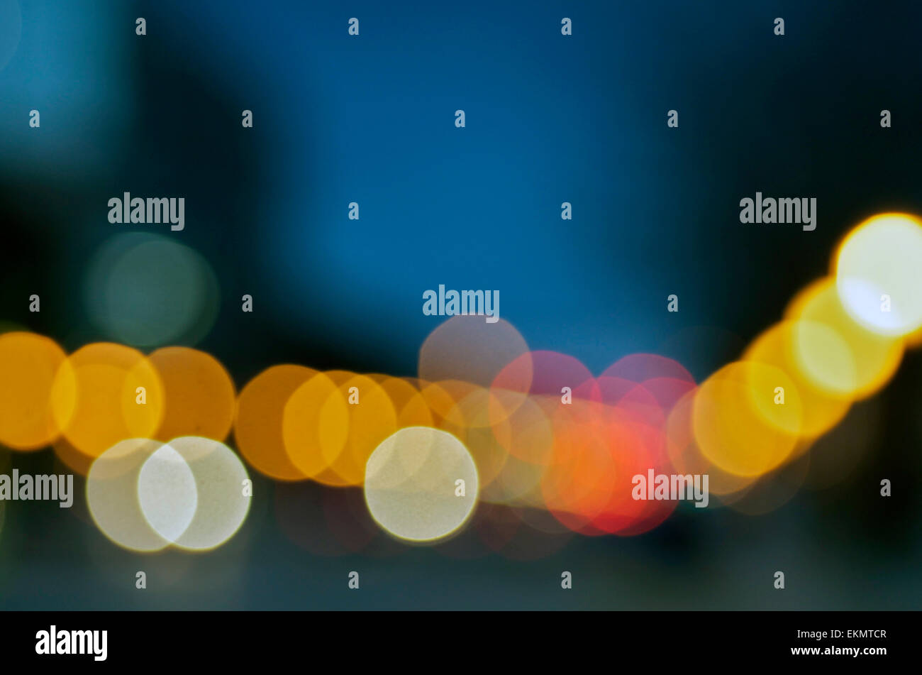 Unfocused lights in orange and yellow. - Stock Image