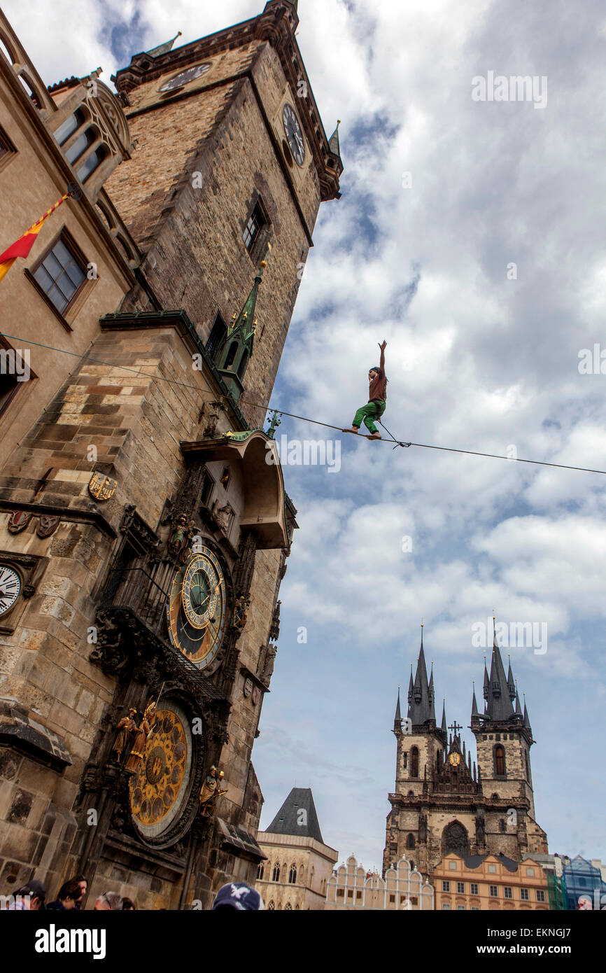 Tightrope walker on the lane in front of the Astronomical Clock, Town Hall Tower Prague Czech Republic - Stock Image