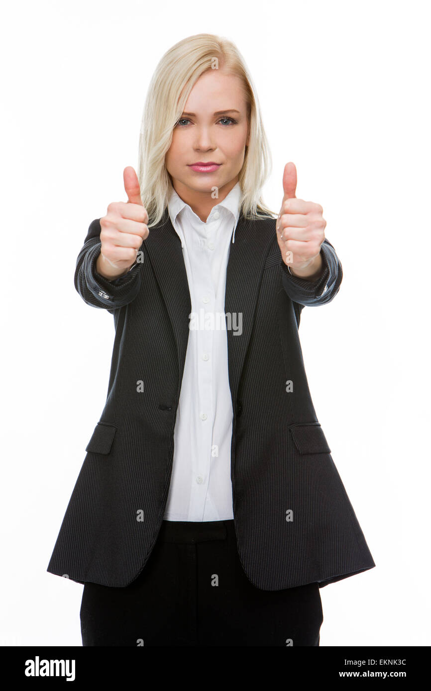 serious blonde businesswoman thumbs up with both hands - Stock Image