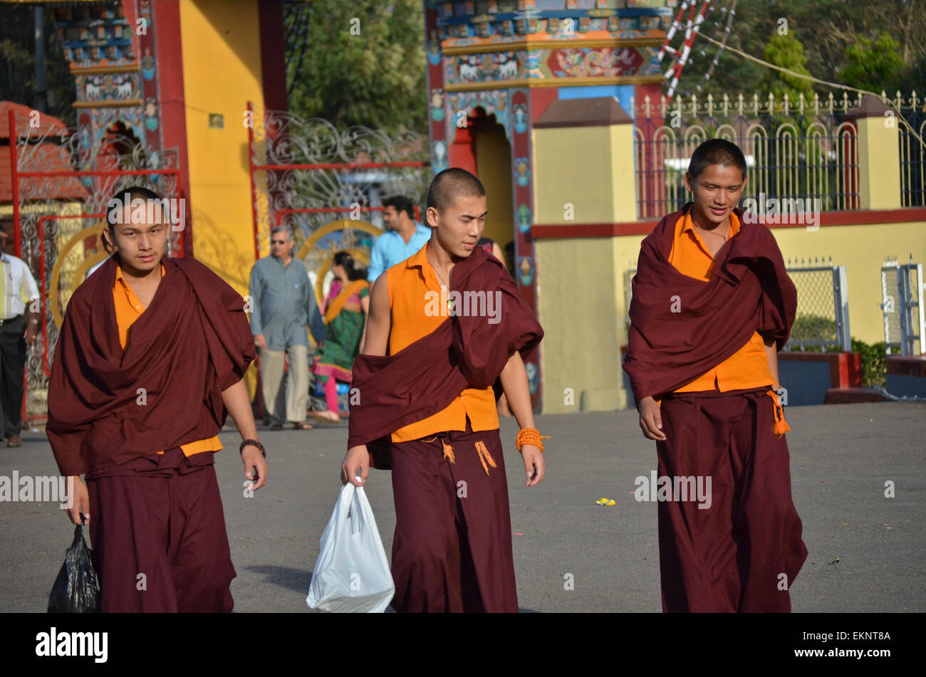 Buddhists Tibetan monks in a traditional dress in front of Namdroling Monastery near Bangalore,Karnataka,India - Stock Image