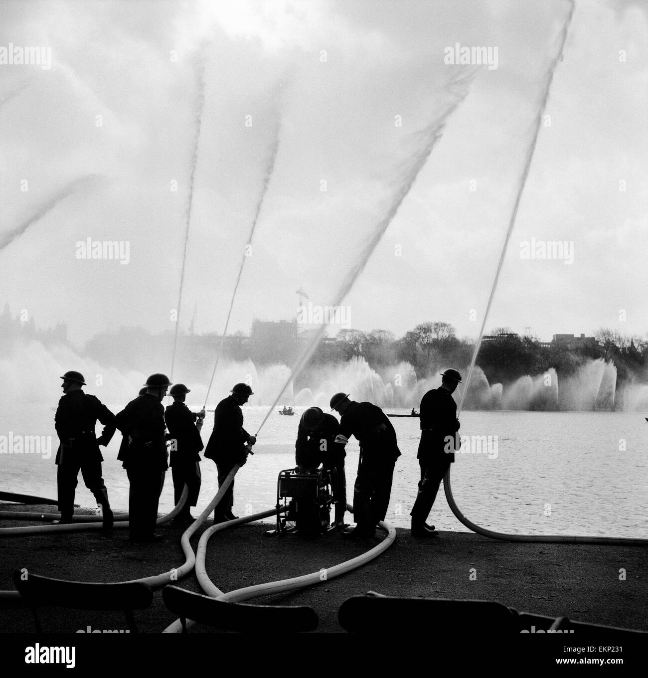 Auxiliary Fire Service exercise in Hyde Park on both sides of the Serpentine. 27th October 1957. - Stock Image