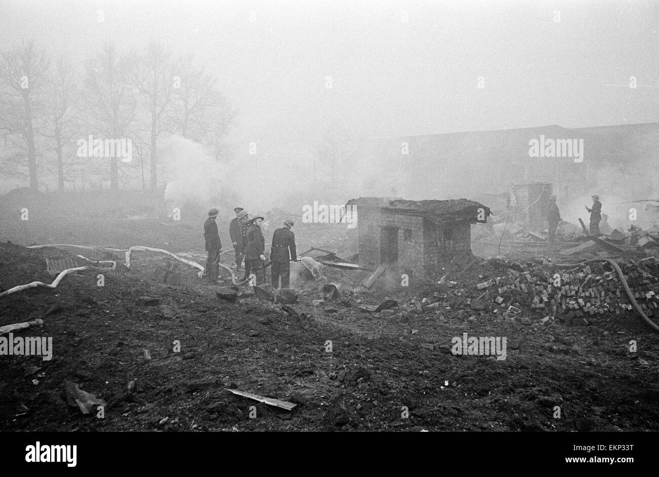 V2 Rocket incident at a brush factory, High Street, Waltham Cross. OPS N.F.S working among the wreckage. 10th January Stock Photo