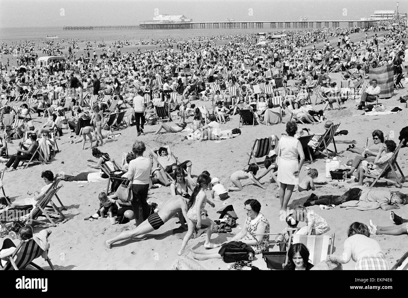 Crowds pack the Central beach at Blackpool on a hot summer's day, Lancashire. 16th July 1972. - Stock Image