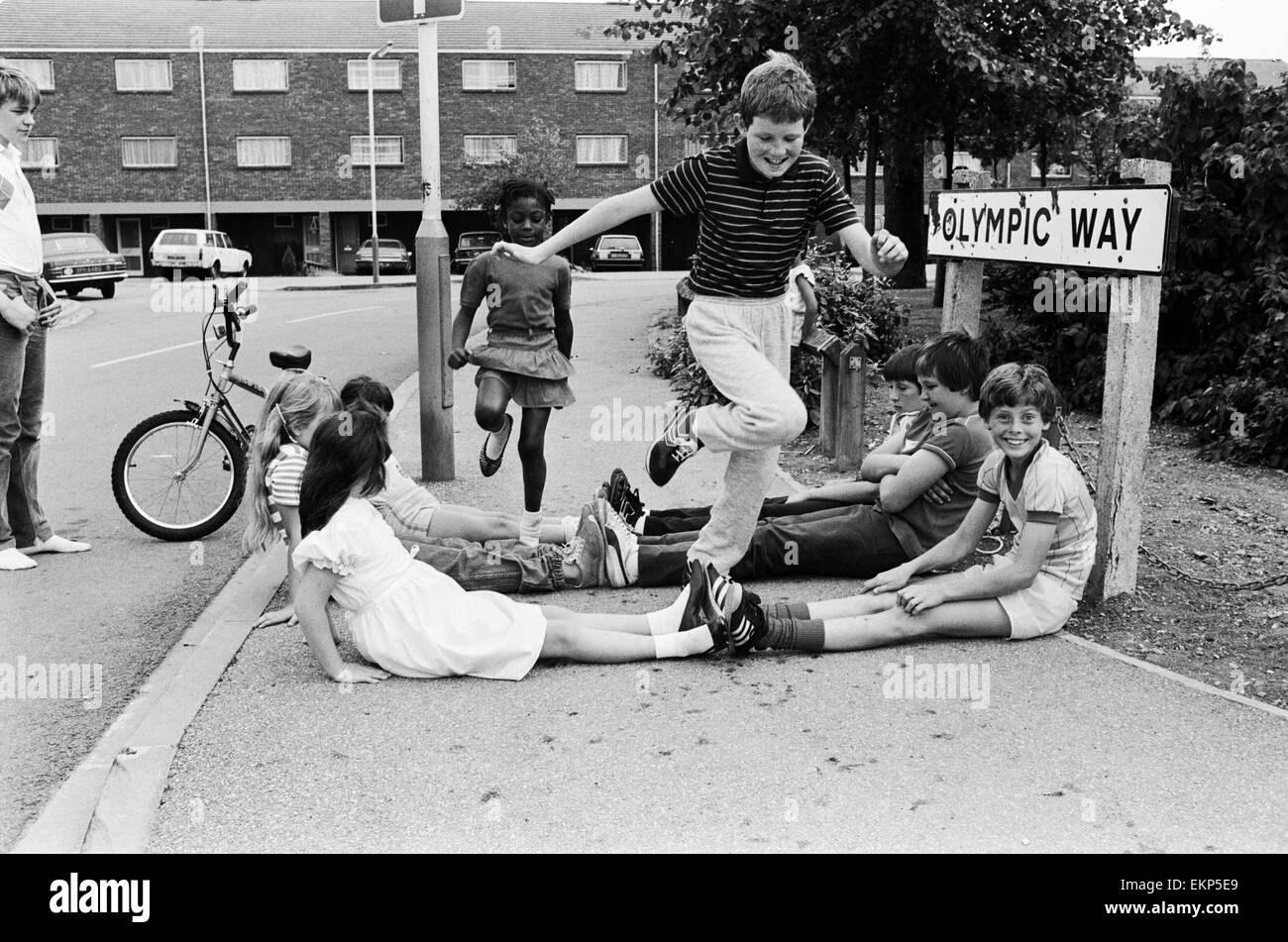 Children of Olympic Way in London, playing a game on the streets outside their homes. 4th August 1984. Stock Photo