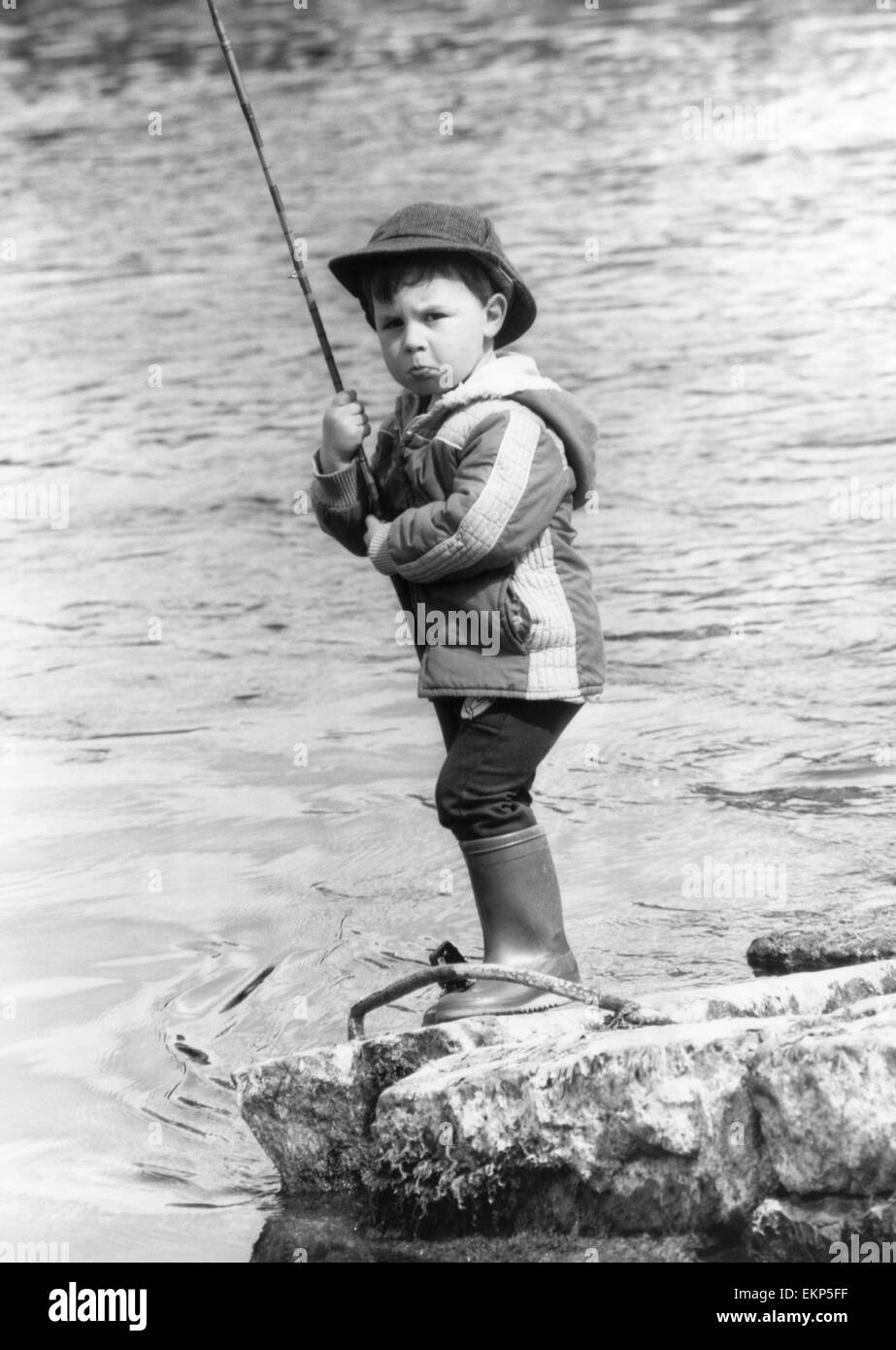 George Miller, Scotland's youngest angler, who can be spotted regularly at the Leven Valley Angling Club near - Stock Image