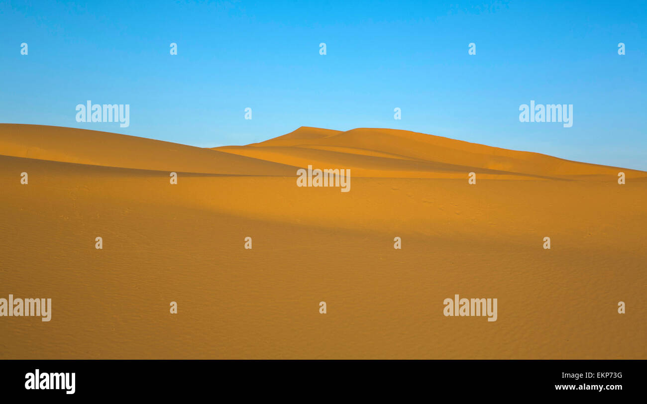 Several sand hill at Erg Chebbi in the Sahara desert.  Ers are large dunes formed by wind-blown sand. Stock Photo