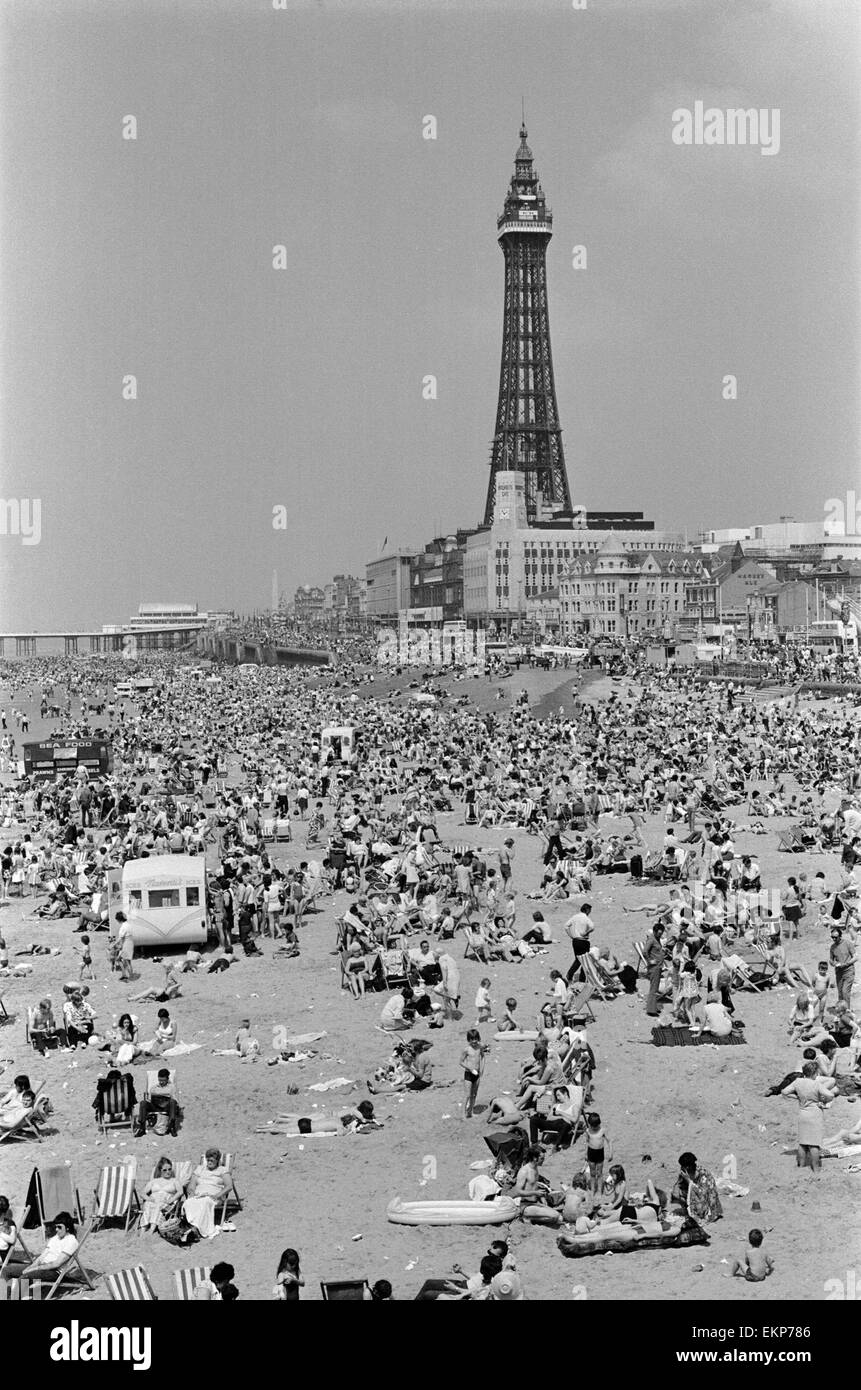 Crowds pack the Central beach at Blackpool on a hot summer's day. 16th July 1972. - Stock Image