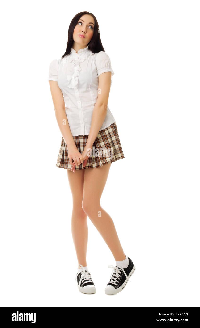 Brunette school girl in checked skirt and long socks-31750