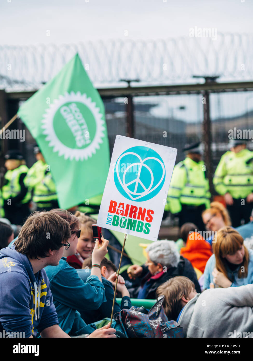 Glasgow, UK. 13th April, 2015. Protestors of all ages gather at Faslane Naval base in Glasgow to capmpaign against - Stock Image