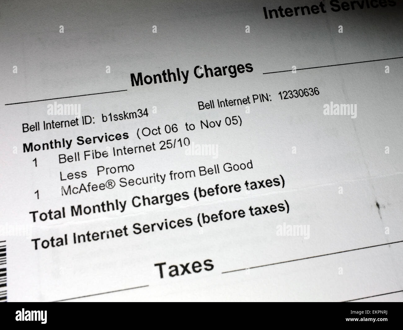 Paperwork with monthly charges on it. - Stock Image