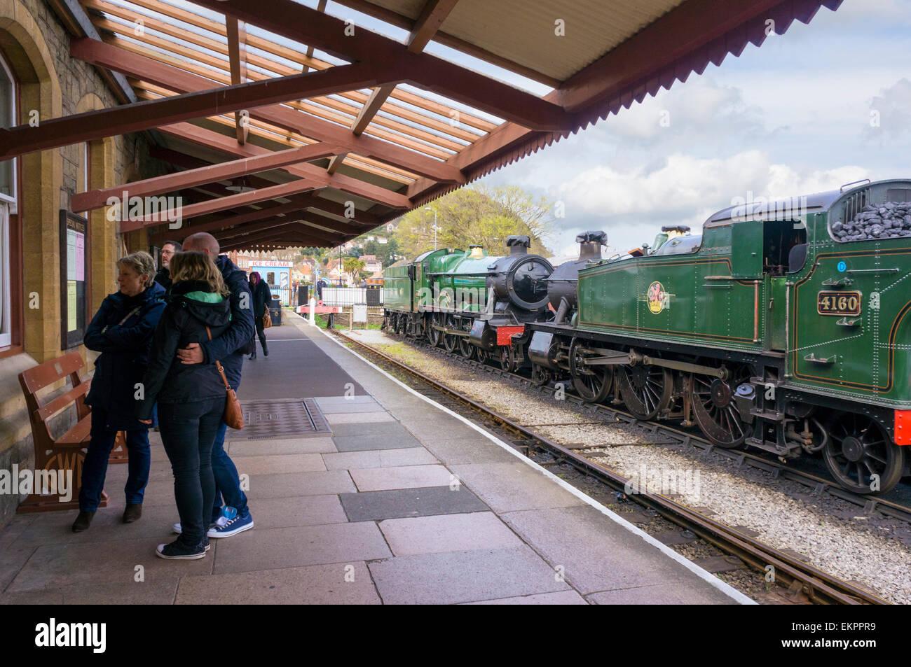 Steam trains and platform at West Somerset Railway station, Minehead, UK - Stock Image