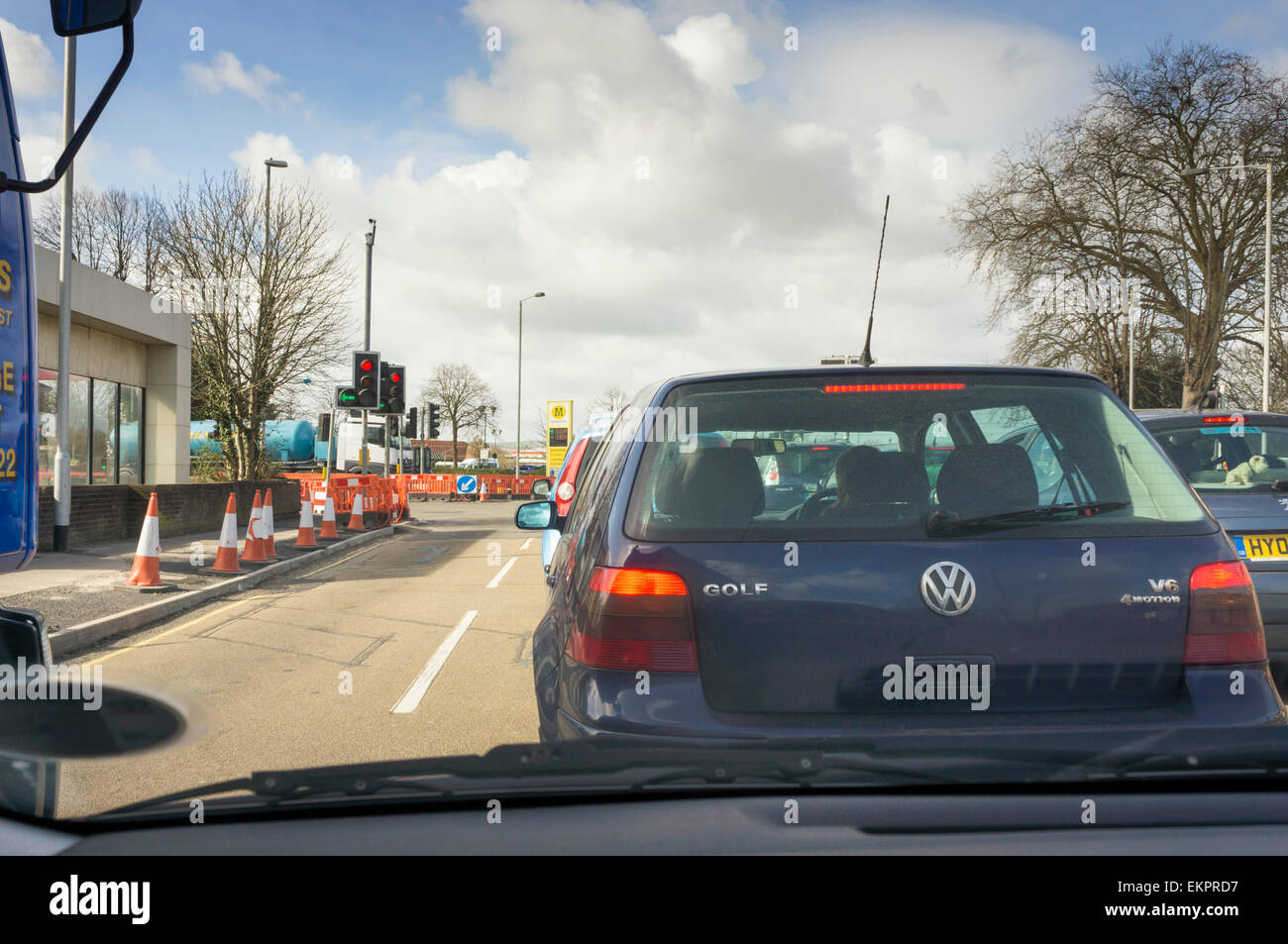 Traffic jam of cars queuing at traffic lights with road works, England, UK - Stock Image