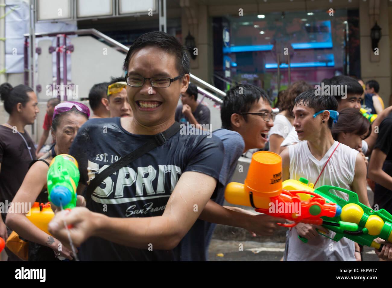 Bangkok, Thailand. 13th April, 2015. Revelers take part in the annual Songkran festival on Silom Road, Bangkok on - Stock Image