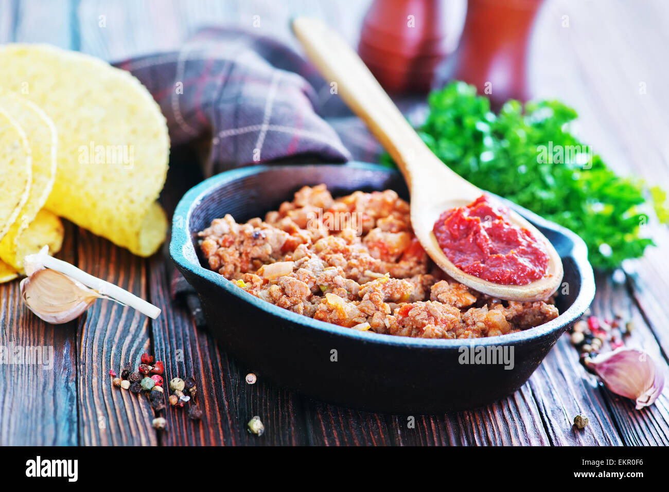 a bowl of fried ground meat with tomatoes ready for tacos Stock Photo