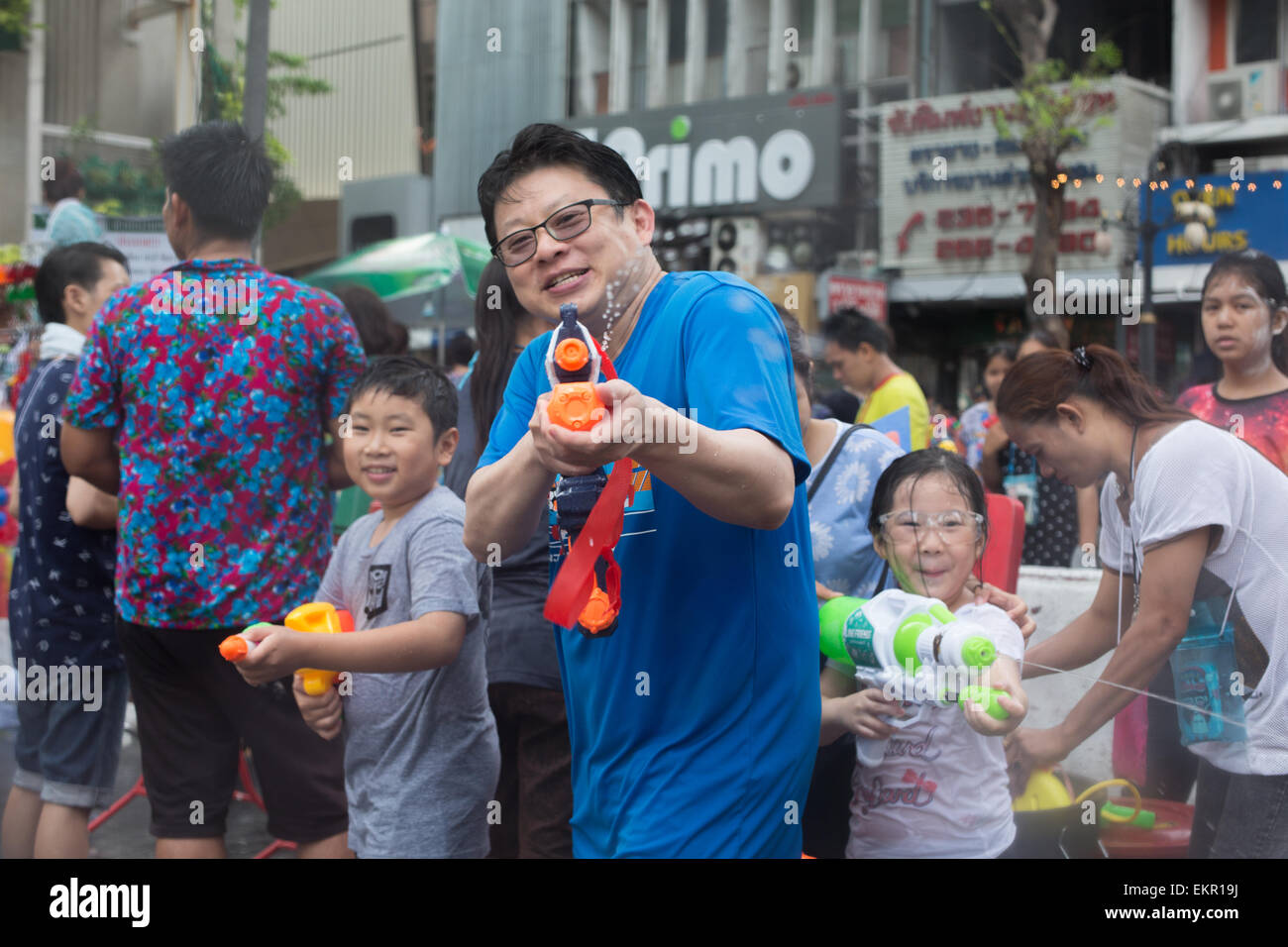 Bangkok, Thailand. 13th April, 2015. A family takes part in the annual Songkran festival on Silom Road, Bangkok - Stock Image