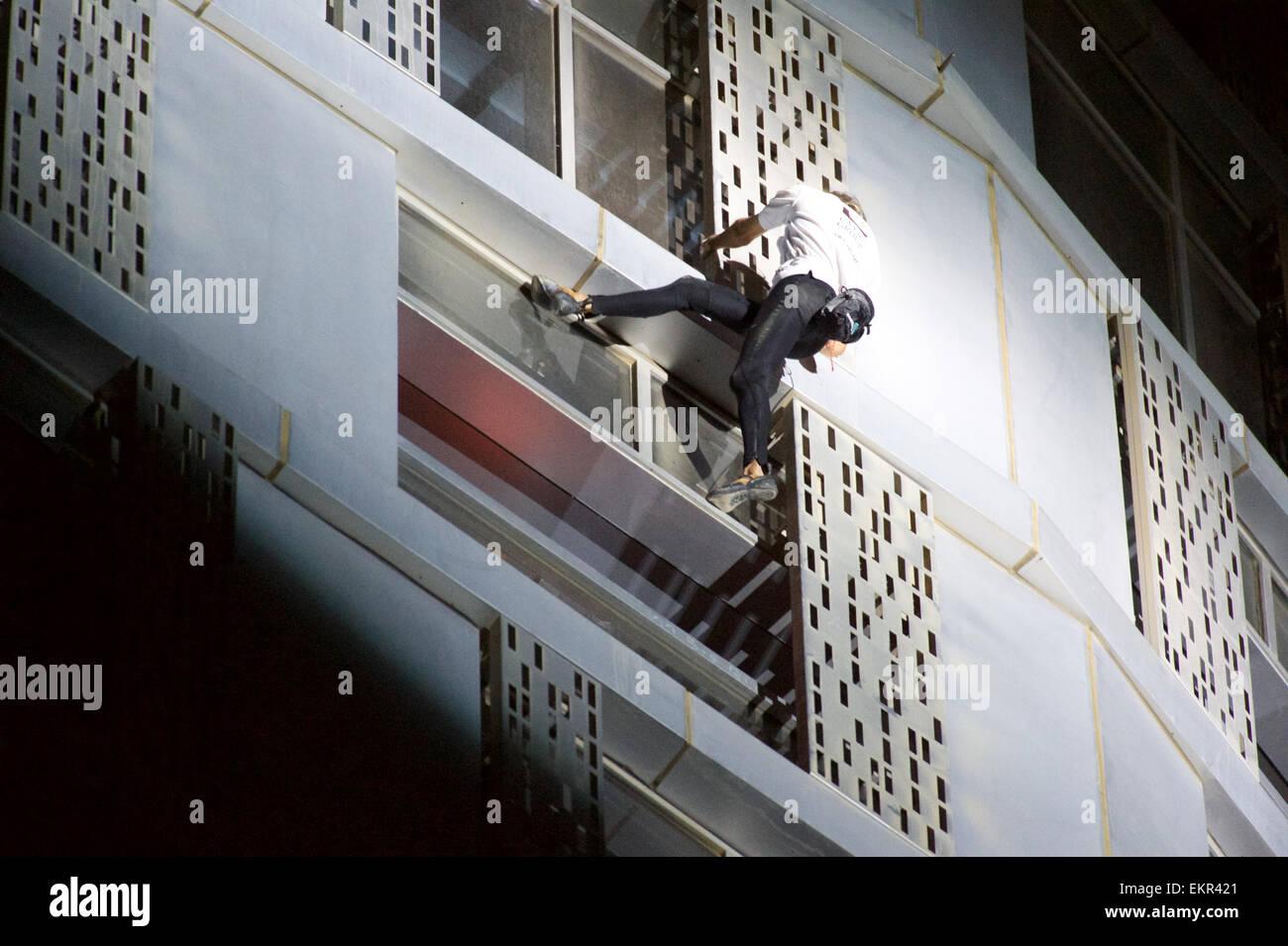 Dubai Marina, Dubai, UAE. 12th April, 2015.  French 'Spiderman' Alain Robert free climbed the 306m high, - Stock Image