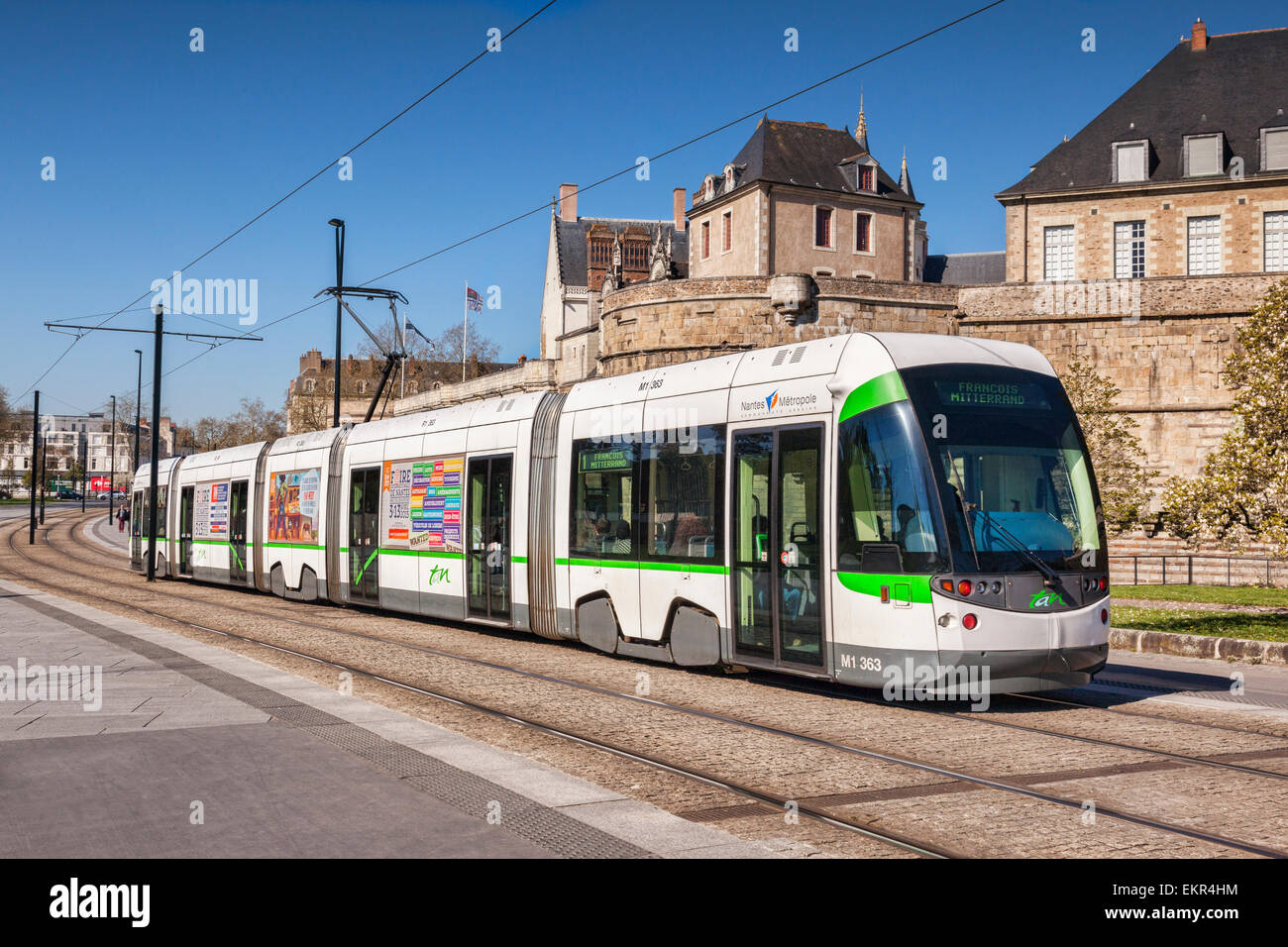 Tram passing the Chateau of the Dukes of Brittany, Nantes, Loire Atlantique, France. - Stock Image