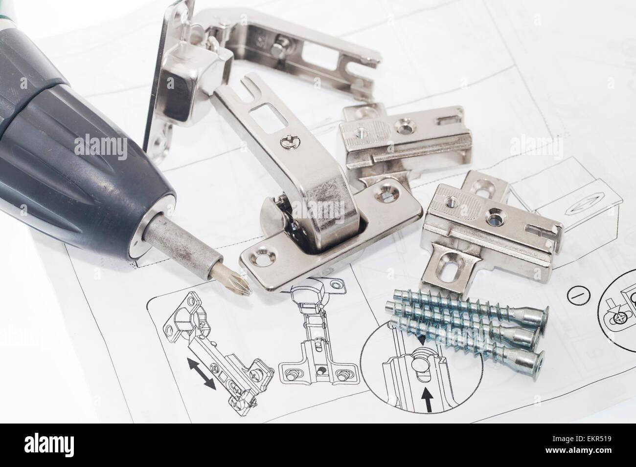 Concealed hinge mounting instruction - Stock Image