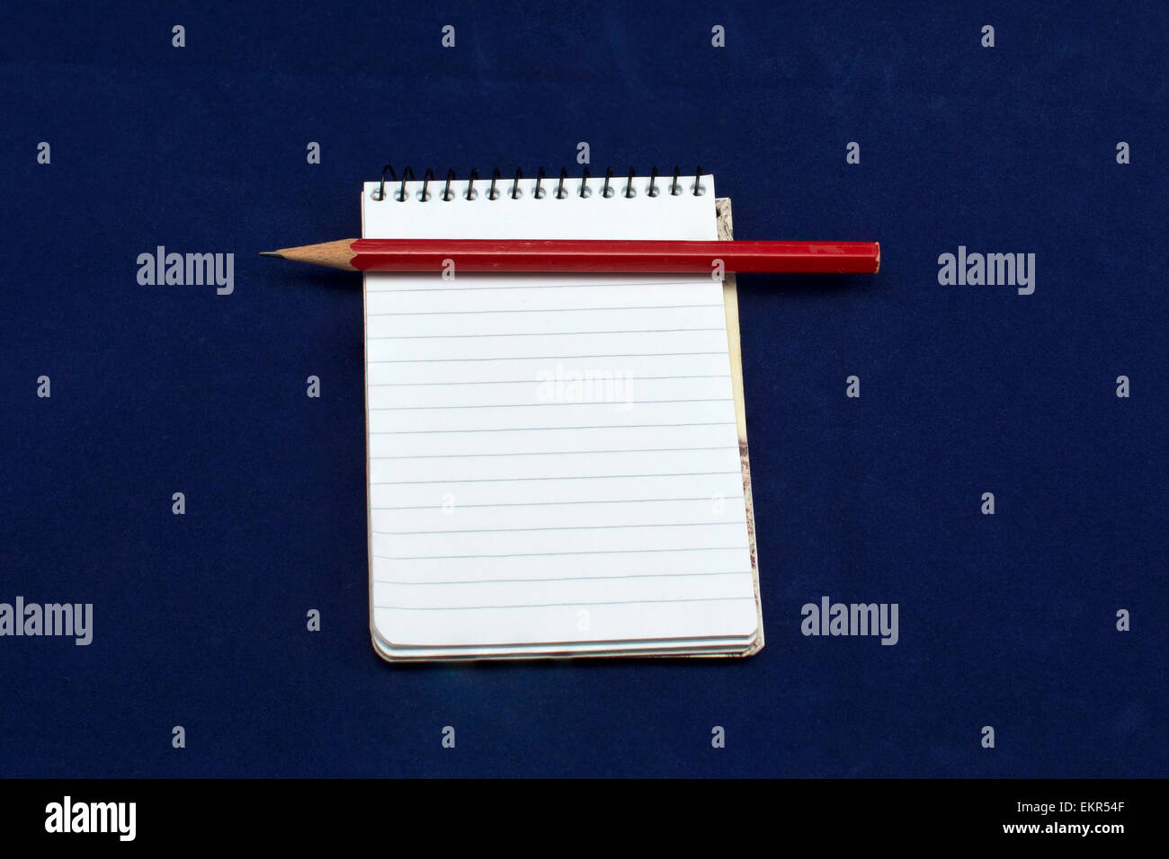 Note book and red pencil Stock Photo