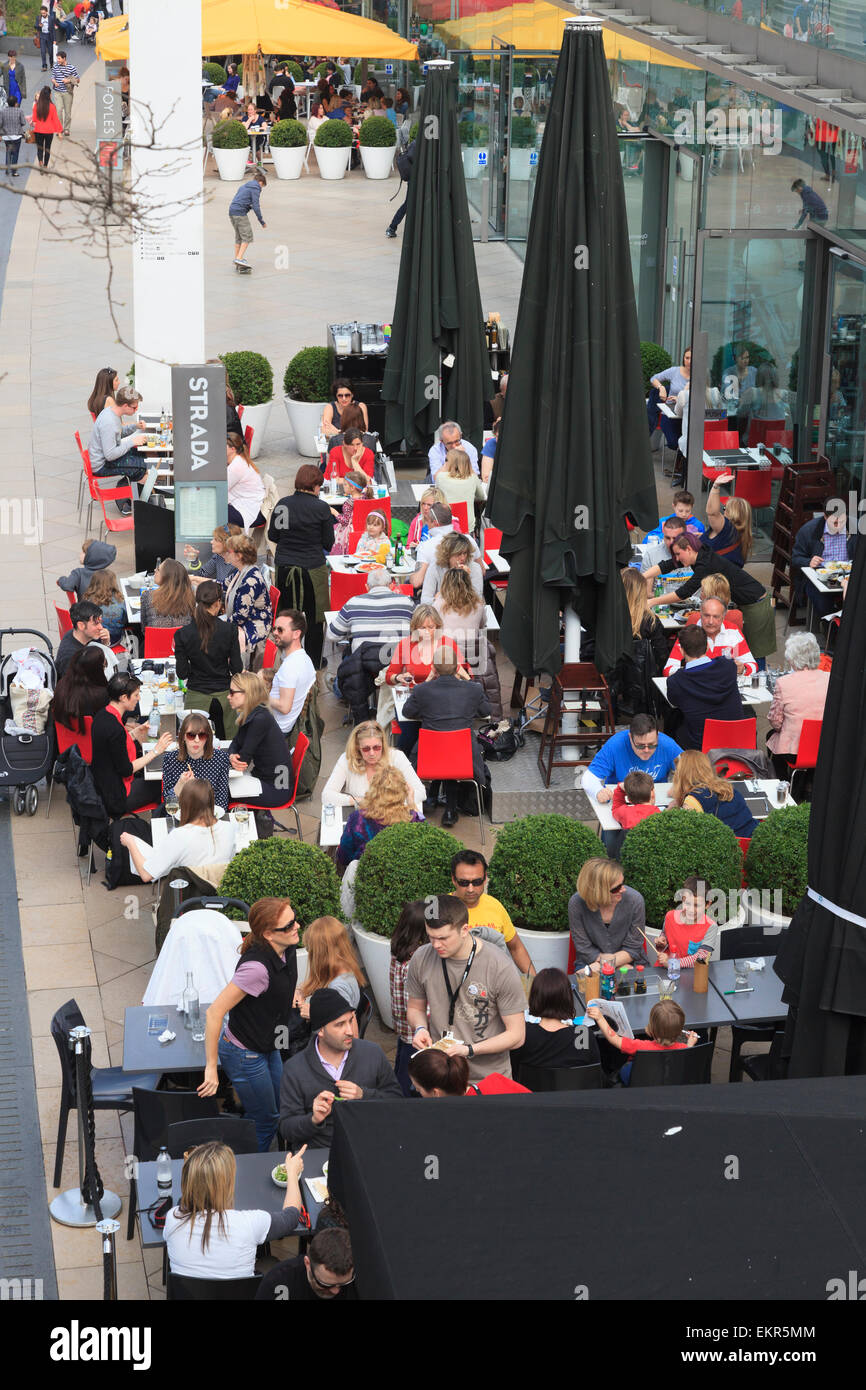 Looking down on a busy Strada street restaurant on the south bank of London Stock Photo