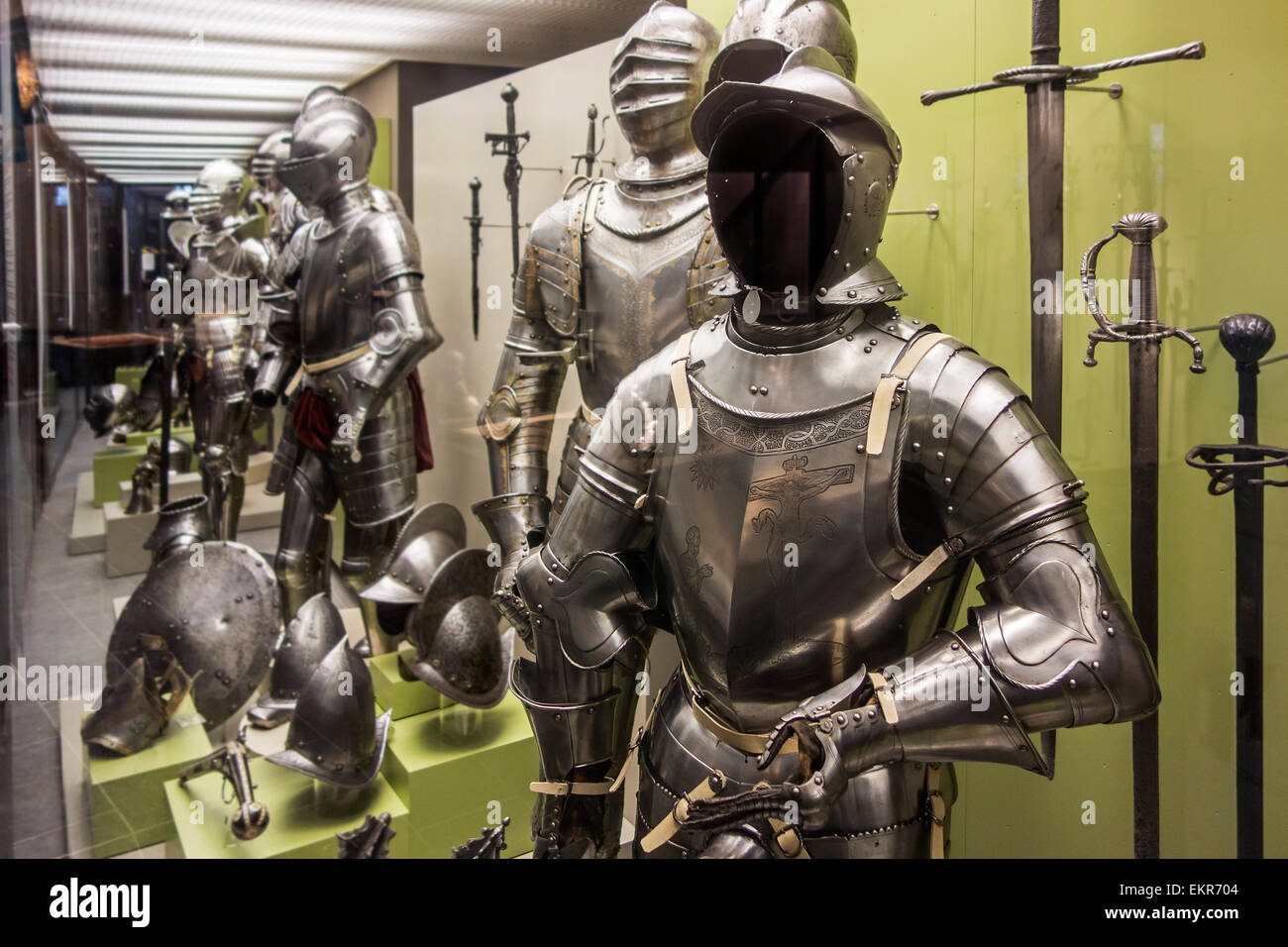 Collection of medieval suits of armour and weapons at the Royal Museum of the Army and of Military History in Brussels, - Stock Image