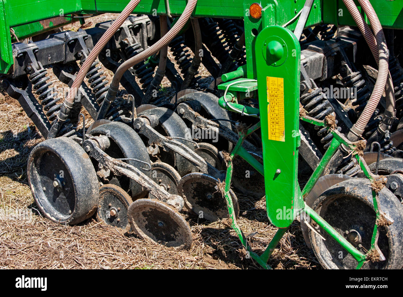 Close up of John Deere 750A no-till seed drill working on farmland - Stock Image