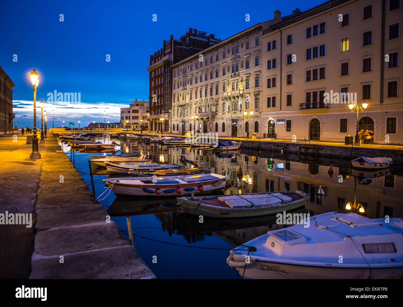 The so-called 'Grande Canale' at dusk in Trieste, a city in the northeast of Italy on the Adriatic Sea. - Stock Image