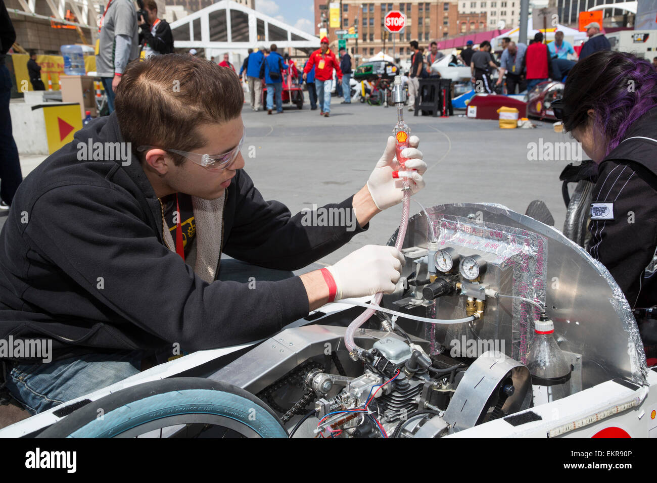 Detroit, Michigan - A member of the University of British Columbia team checks his car's fuel tank in the Shell - Stock Image