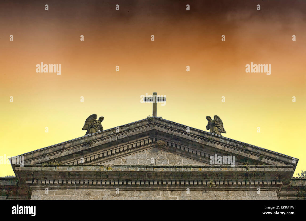 Pediment of a church with a threatening sky, Santiago de Compostela, Spain - Stock Image
