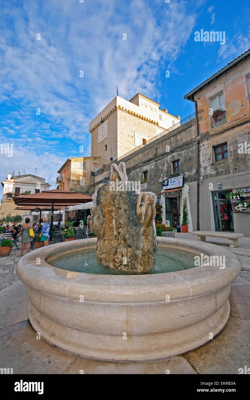 San Felice Circeo, fountain in piazza Vittorio Veneto and Tower of Templar Knights, old town centre, Lazio, Italy - Stock Image