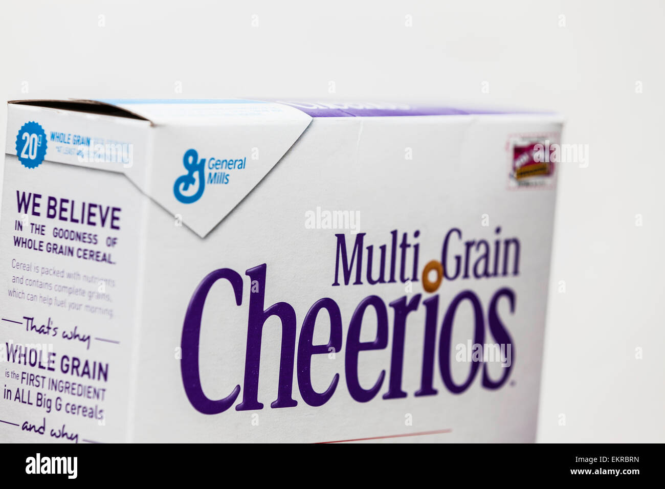 A box of whole grain cheerios and the General Mills Logo.  General Mills is considered a top candidate for a takeover. - Stock Image