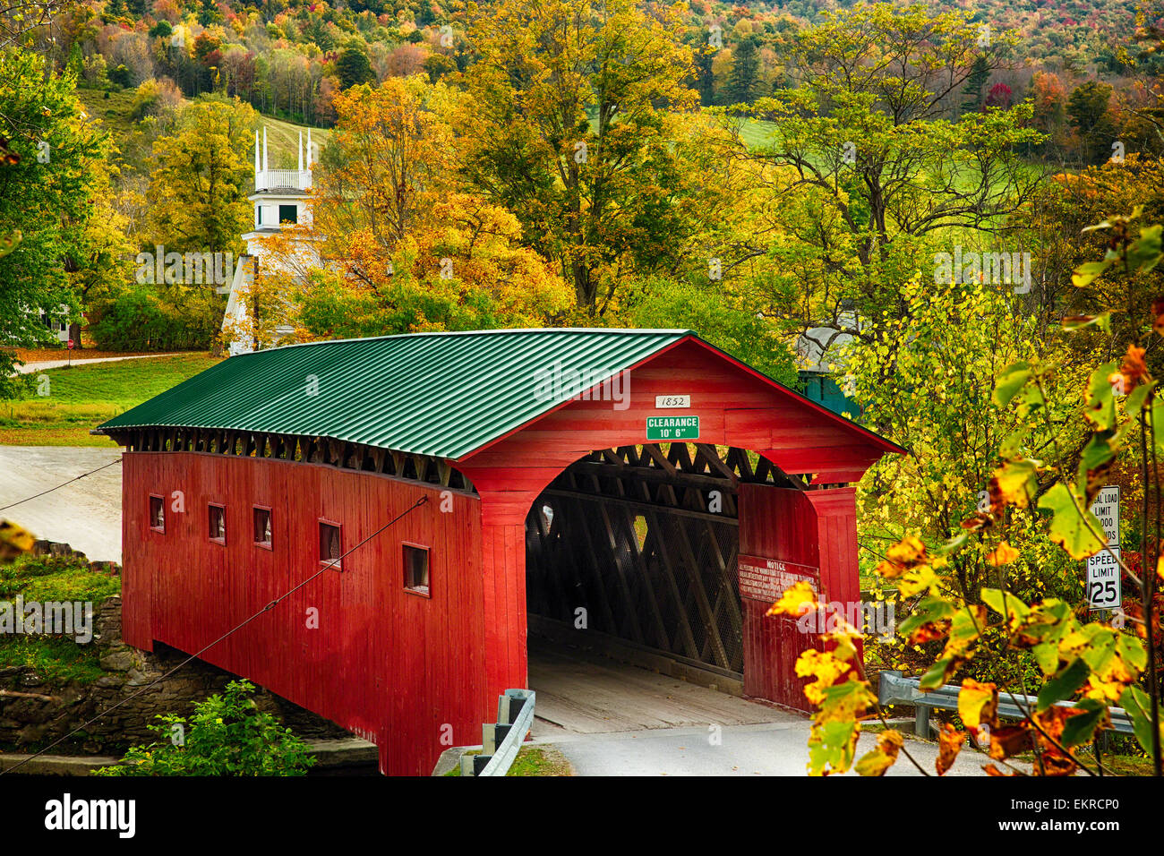 High Angle View of a Covered Bridge with a Church Tower in the Background, West Arlington, Grafton County, Vermont - Stock Image