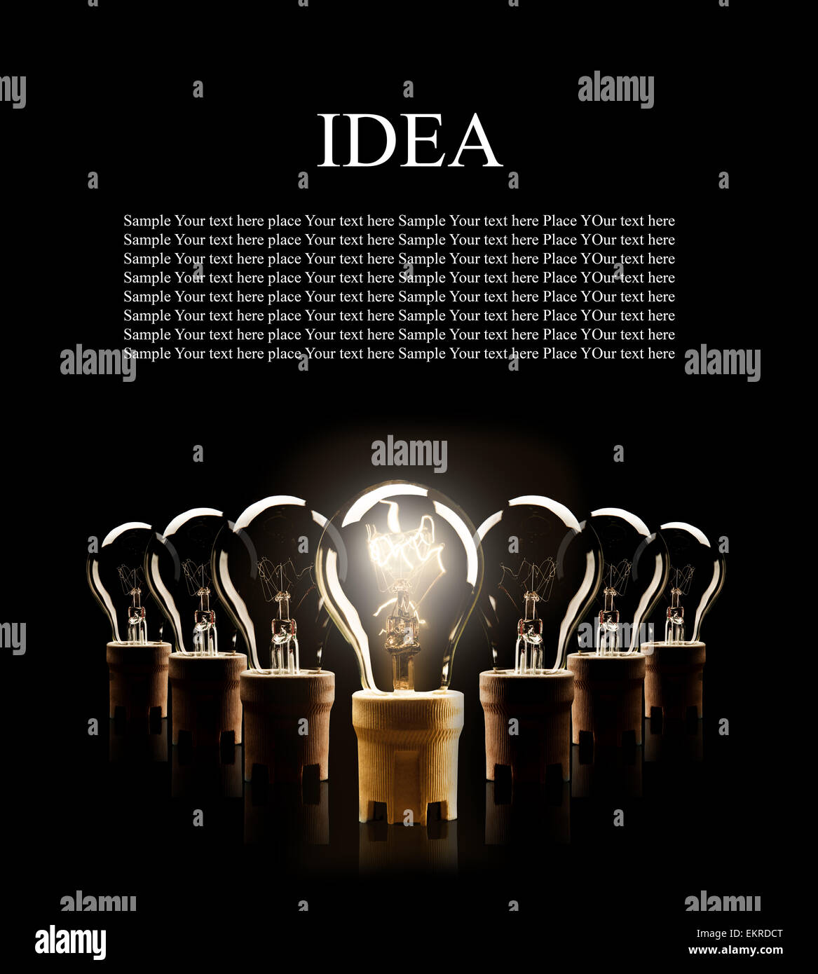 Light bulbs in rows with single one shinning, isolated on black background - Stock Image