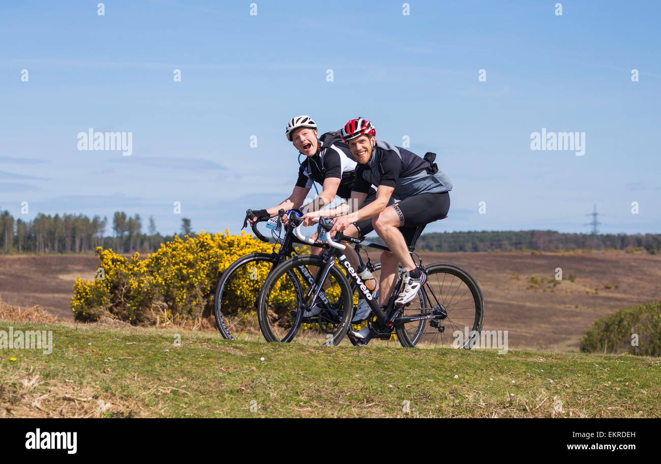 Two male cyclists compete in the New Forest Wiggle Sportive event on a sunny Sunday in Spring Stock Photo
