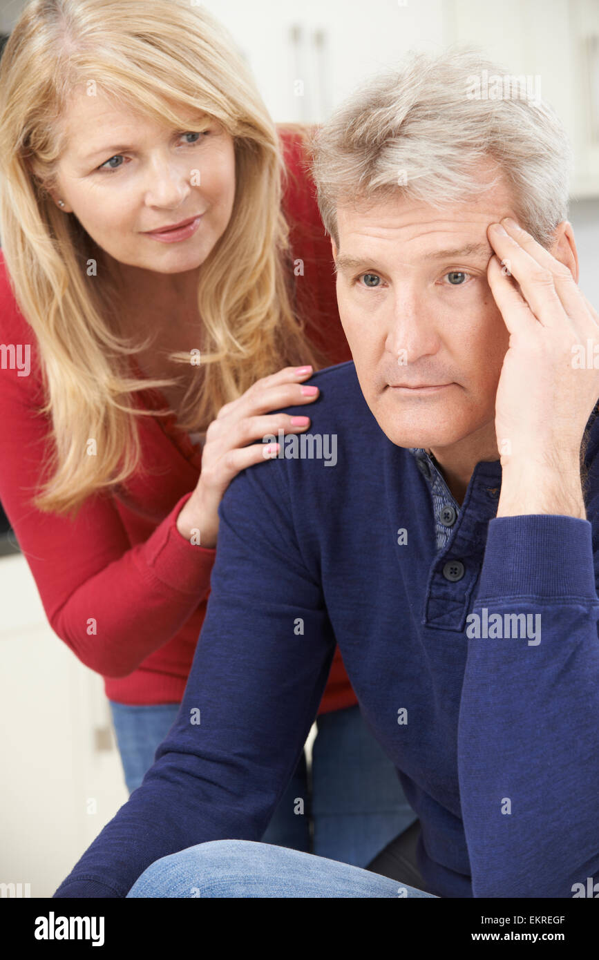 Mature Woman Comforting Man With Depression Stock Photo