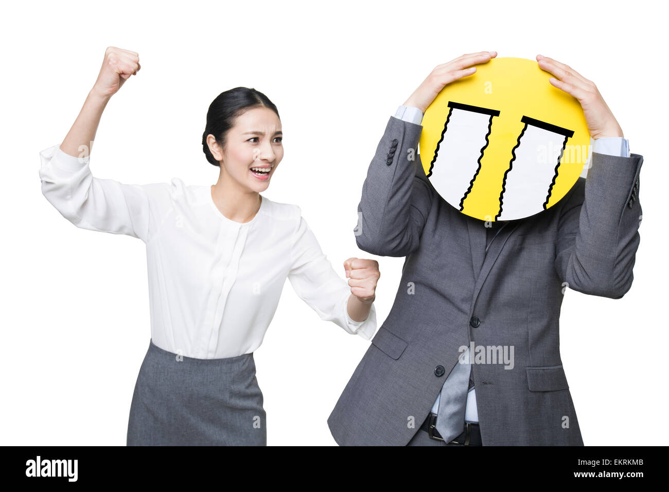 Young businesswoman scolding businessman - Stock Image