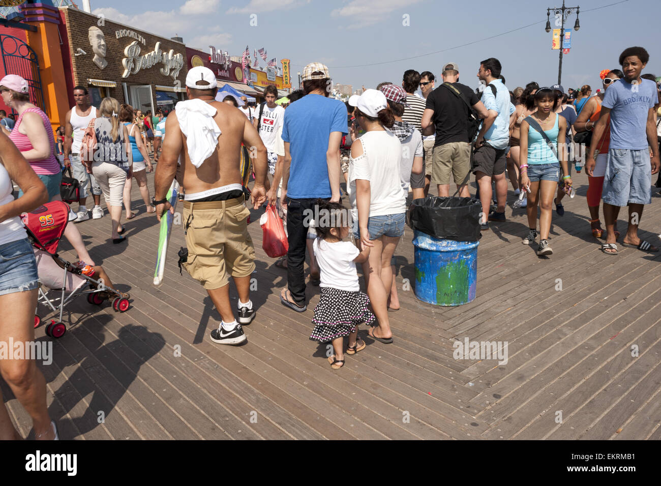 Crowds line the boardwalk at Coney Island in Brooklyn, NY on the 4th of July, 2012 during  the second heat wave - Stock Image