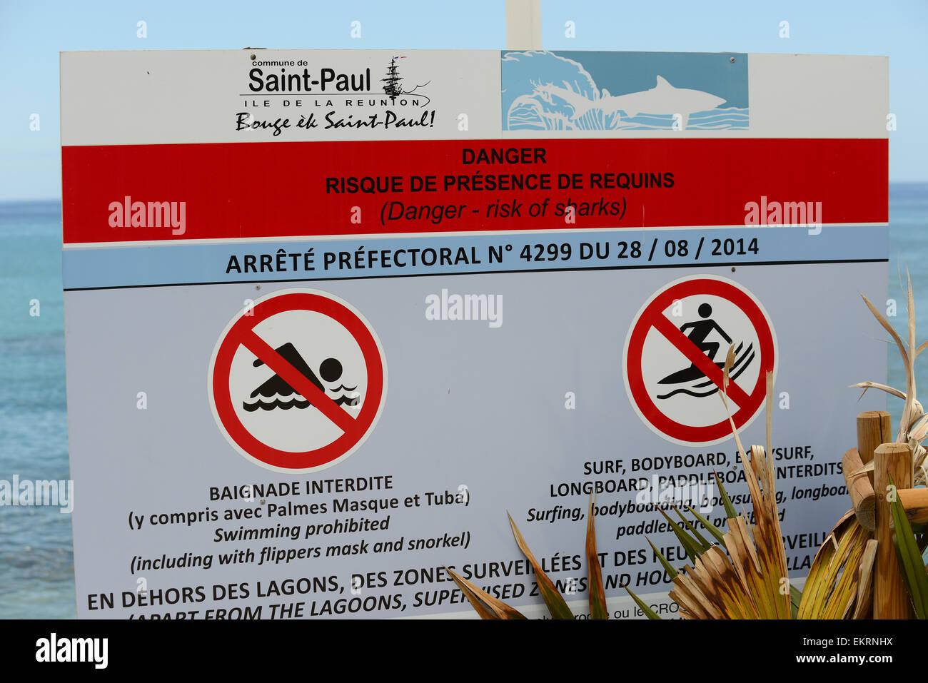 11b6d1693f No swimming signs warning of sharks on the beach at Saint Paul, Saint-Gilles
