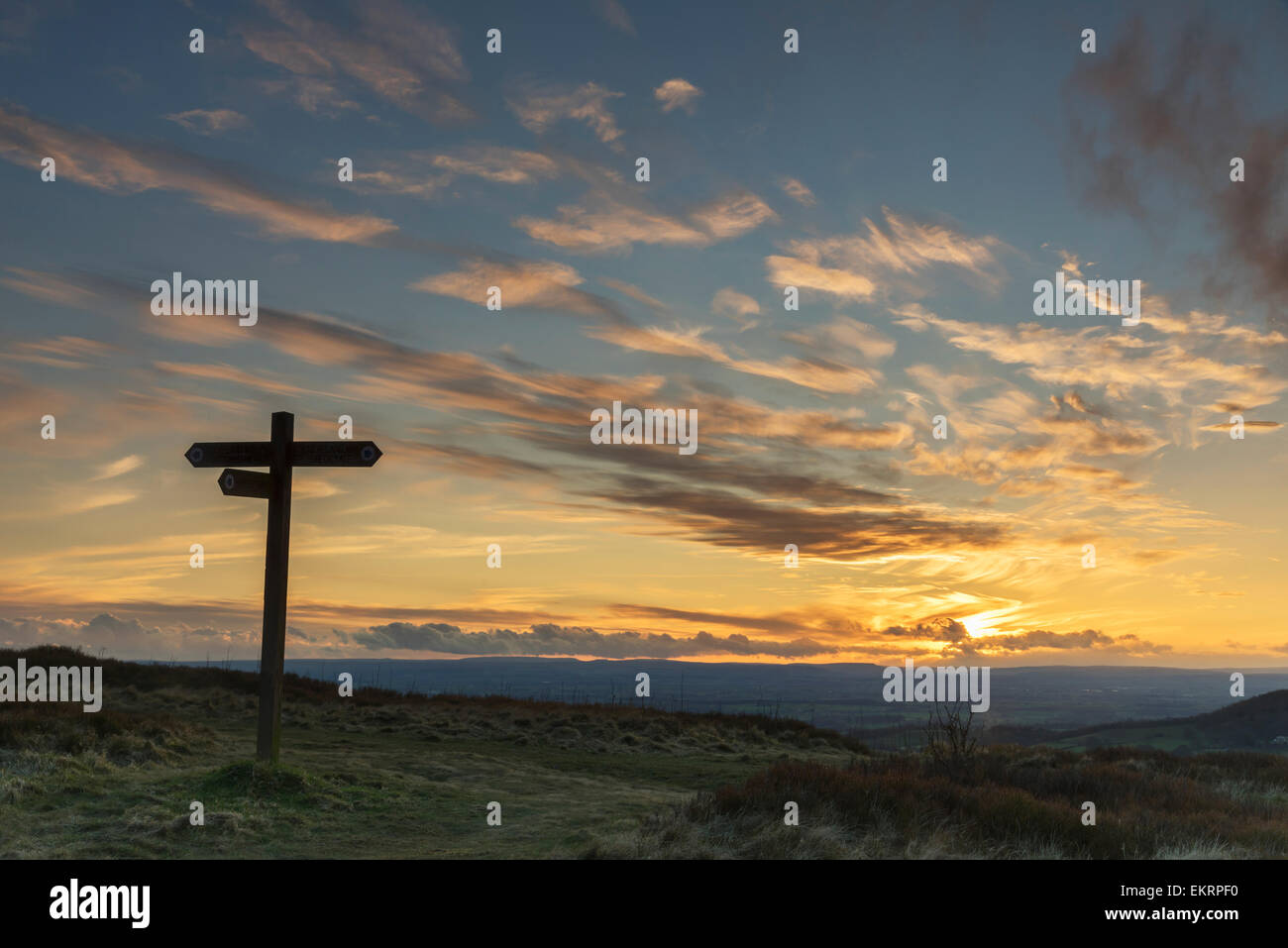 A signpost at sunset along The Cleveland Way in North Yorkshire, England. - Stock Image