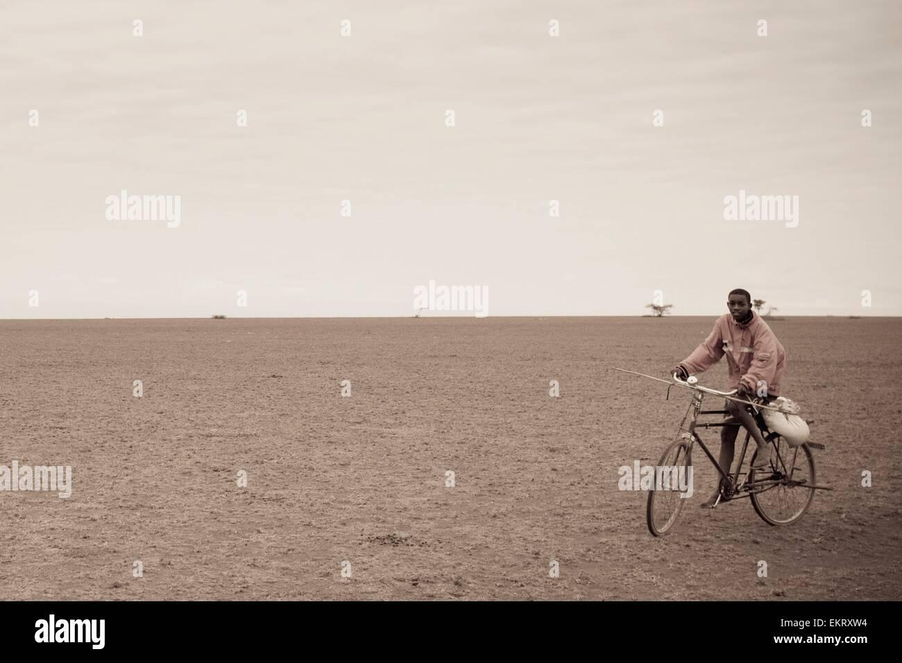 Man Riding A Bike, Kenya, Africa - Stock Image