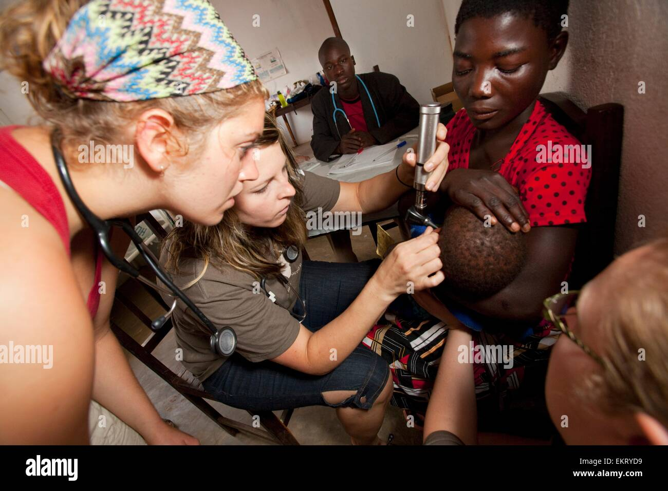 Medical Team Does A Check Up On A Small Child; Manica, Mozambique, Africa - Stock Image