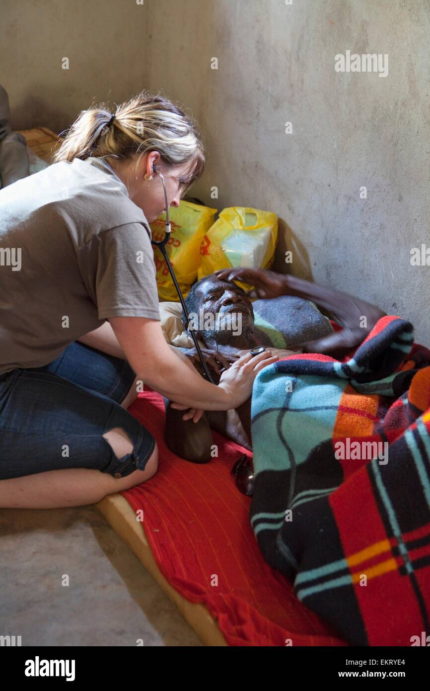 A Nurse Checks A Man Dying Of Pneumonia; Manica, Mozambique, Africa - Stock Image
