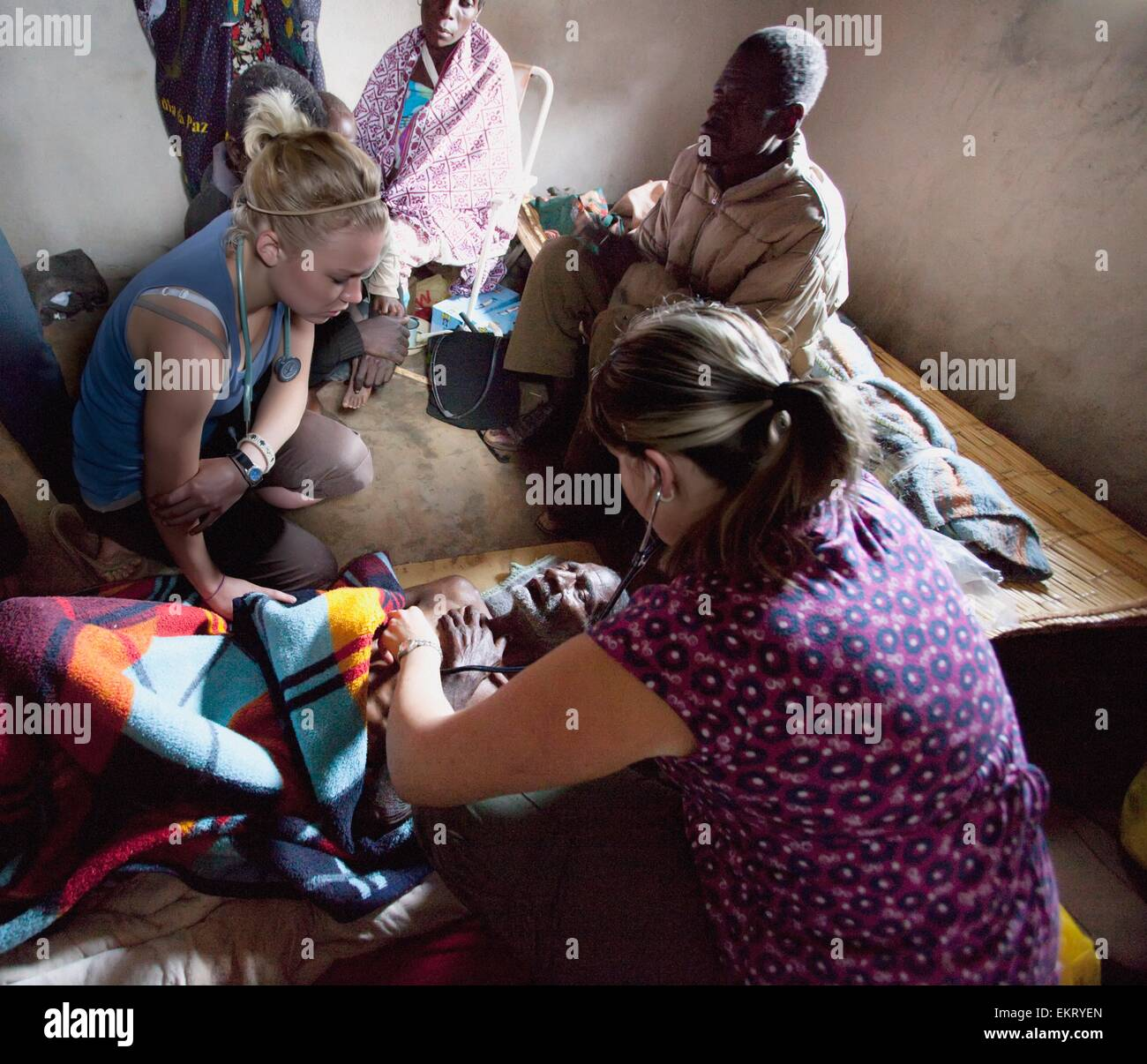 Nurses Tending To An Old Man Dying Of Pneumonia; Manica, Mozambique, Africa - Stock Image