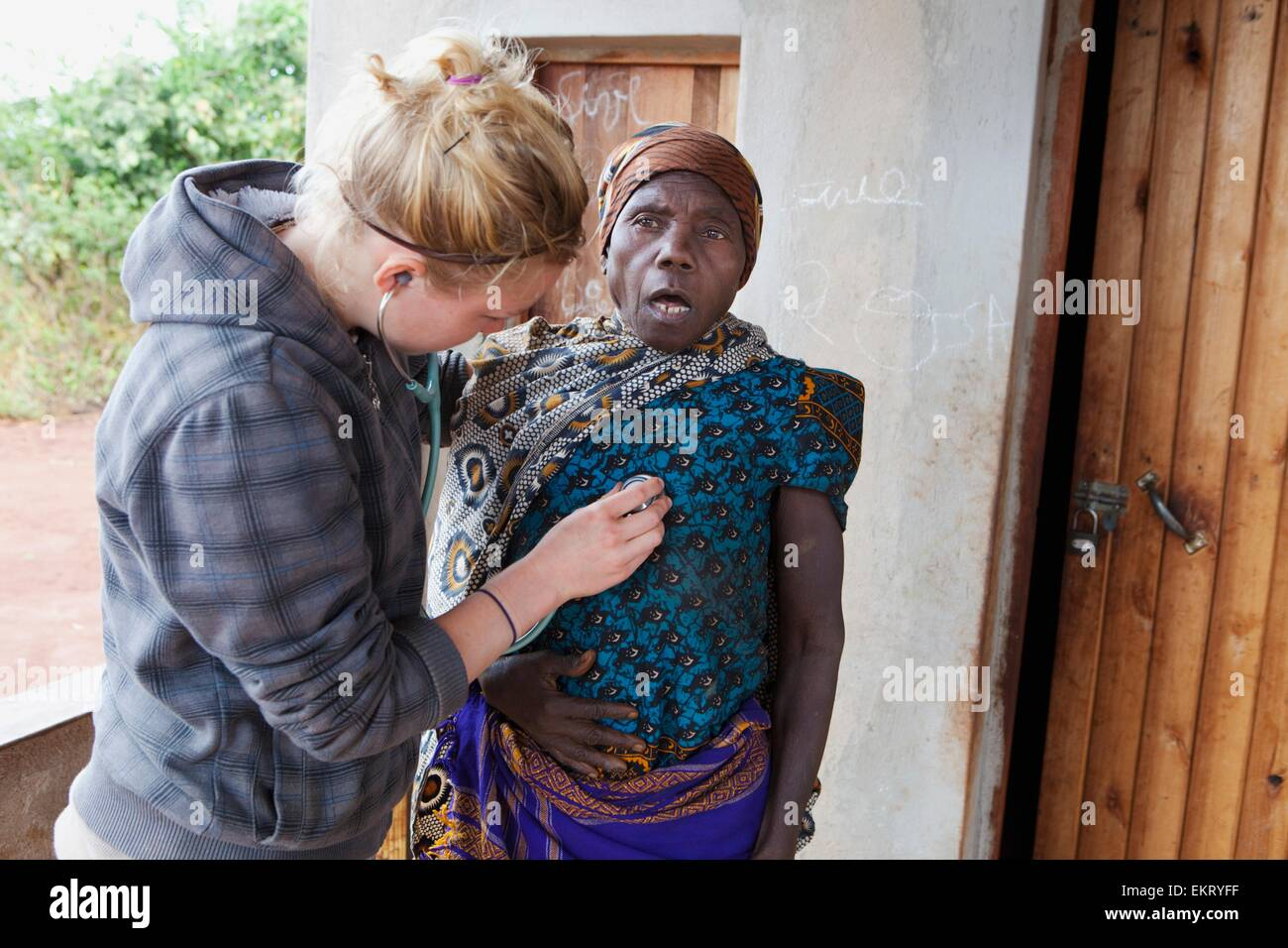 A Nurse Does A Check Up On A Senior Woman; Manica, Mozambique, Africa - Stock Image