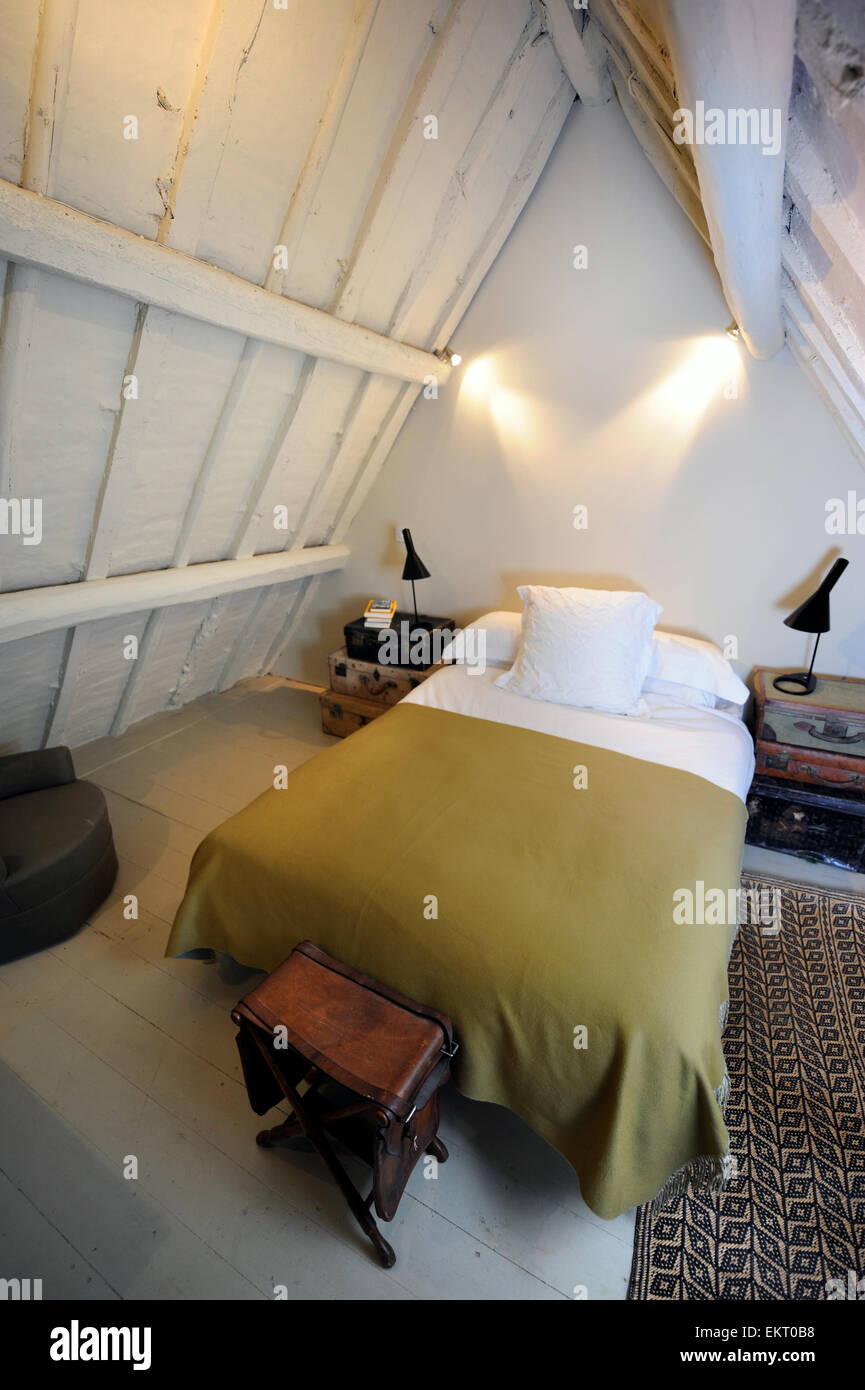 A spare bedroom in the attic space of a country cottage UK Stock Photo