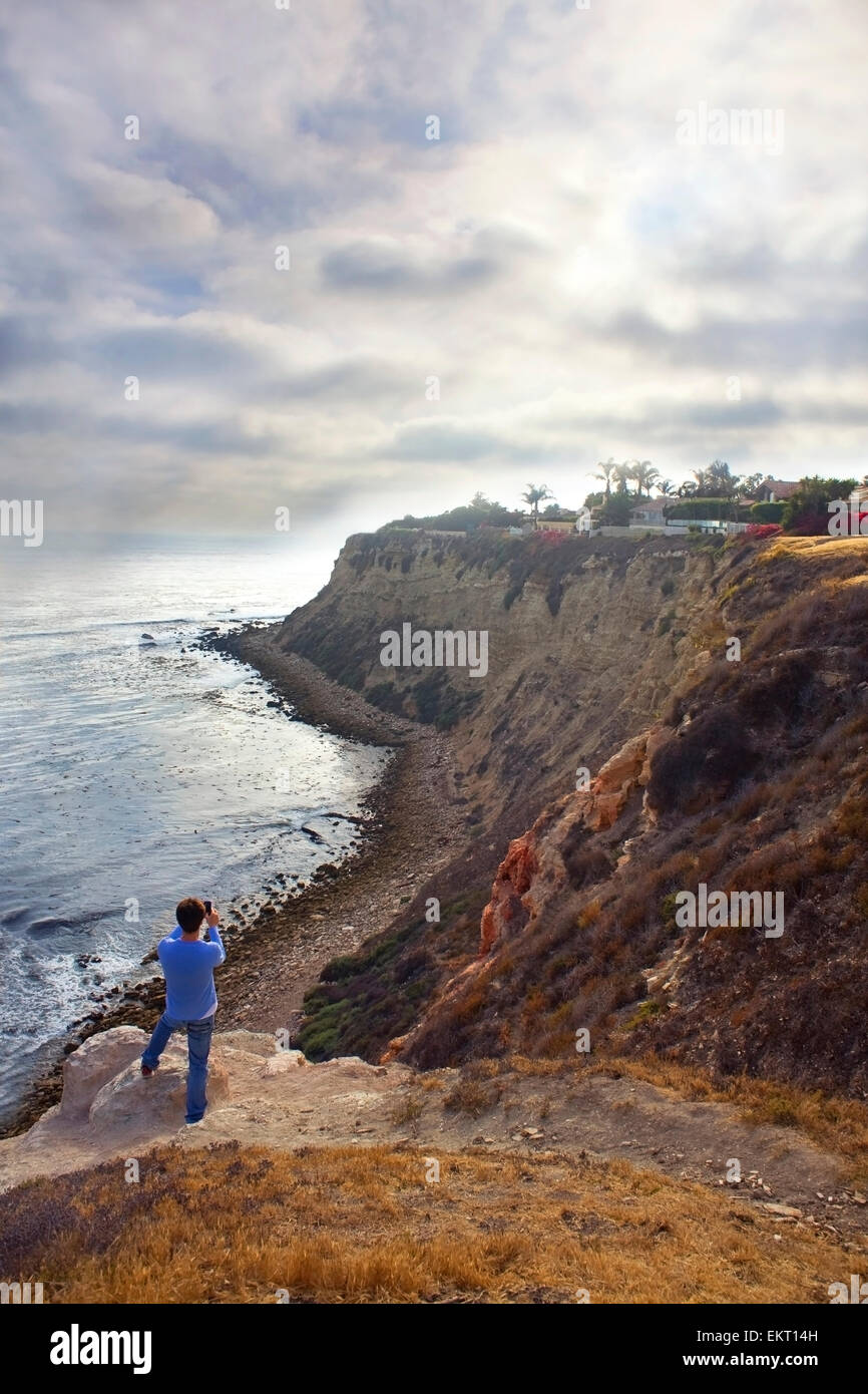 Man Taking A Photo Of The Ocean And Cliffs, Palos Verdes, California - Stock Image